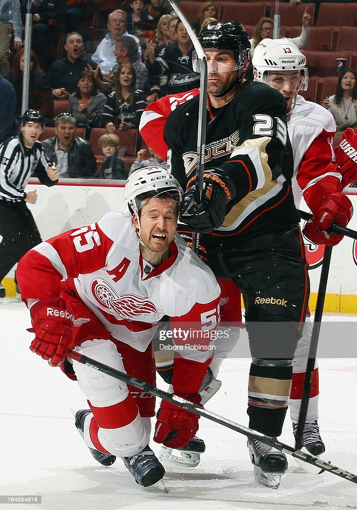 <a gi-track='captionPersonalityLinkClicked' href=/galleries/search?phrase=Niklas+Kronwall&family=editorial&specificpeople=220826 ng-click='$event.stopPropagation()'>Niklas Kronwall</a> #55 of the Detroit Red Wings takes a shot to the head at center ice from <a gi-track='captionPersonalityLinkClicked' href=/galleries/search?phrase=Francois+Beauchemin&family=editorial&specificpeople=604125 ng-click='$event.stopPropagation()'>Francois Beauchemin</a> #23 of the Anaheim Ducks on March 24, 2013 at Honda Center in Anaheim, California.