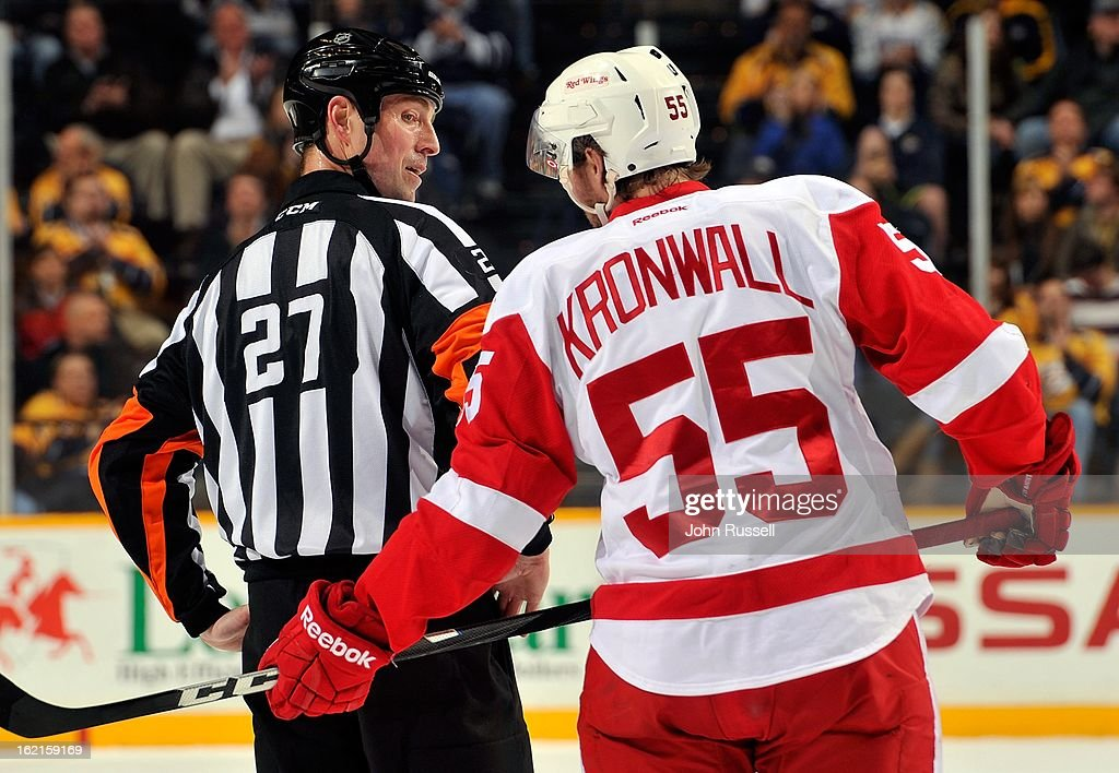 <a gi-track='captionPersonalityLinkClicked' href=/galleries/search?phrase=Niklas+Kronwall&family=editorial&specificpeople=220826 ng-click='$event.stopPropagation()'>Niklas Kronwall</a> #55 of the Detroit Red Wings talks to referee Eric Furlatt #27 during a game against the Nashville Predators at Bridgestone Arena on February 19, 2013 in Nashville, Tennessee.