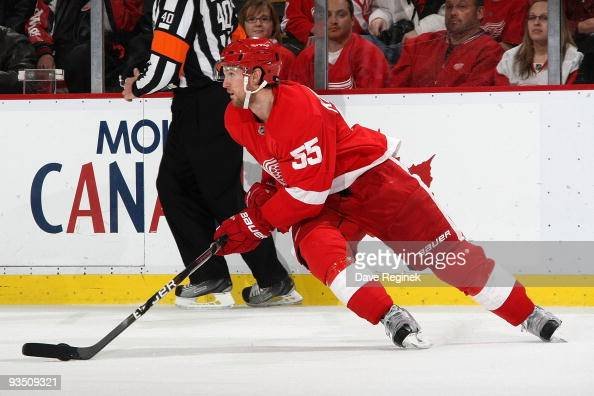 Niklas Kronwall of the Detroit Red Wings turns up ice with the puck during an NHL game against the Florida Panthers at Joe Louis Arena on November 20...