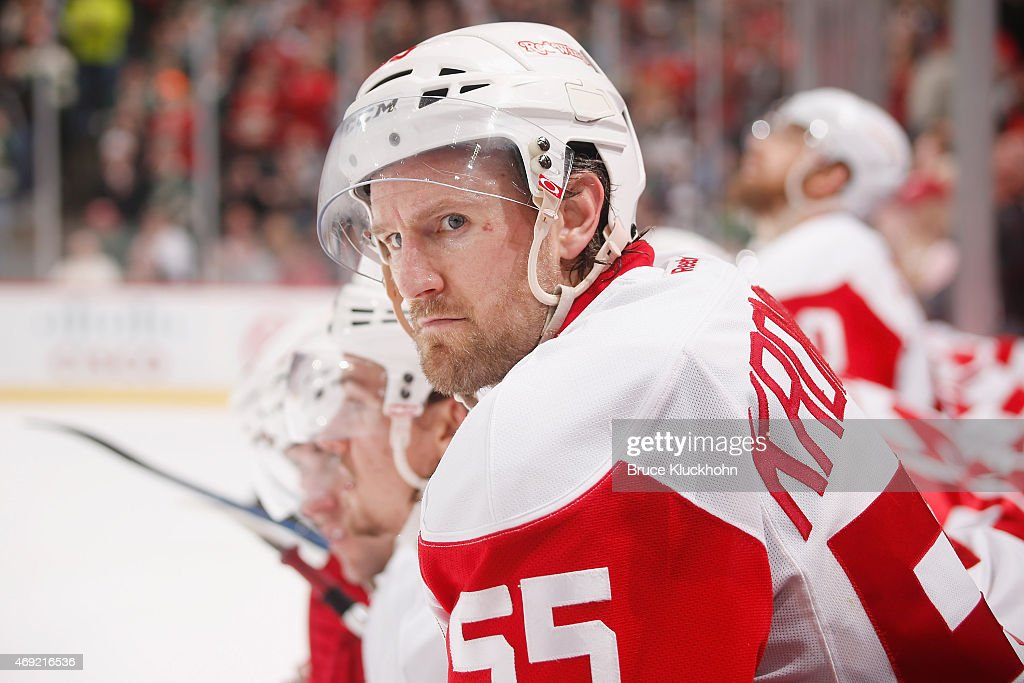 Niklas Kronwall of the Detroit Red Wings watches the overtime shootout from the bench against the Minnesota Wild at the Xcel Energy Center on April 4...