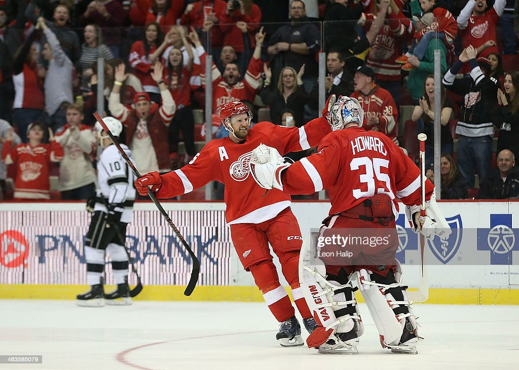 Niklas Kronwell of the Detroit Red Wings celebrates a shootout win over the Los Angeles Kings with goalie Jimmy Howard at Joe Louis Arena on January...