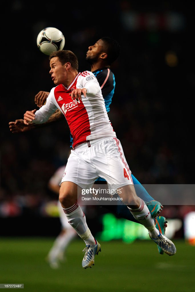 Niklas Moisander of Ajax and Jeremain Lens of PSV battle for the ball during the Eredivisie match between Ajax Amsterdam and PSV Eindhoven at Amsterdam Arena on December 1, 2012 in Amsterdam, Netherlands.