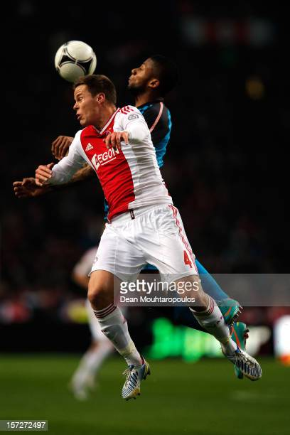 Niklas Moisander of Ajax and Jeremain Lens of PSV battle for the ball during the Eredivisie match between Ajax Amsterdam and PSV Eindhoven at...