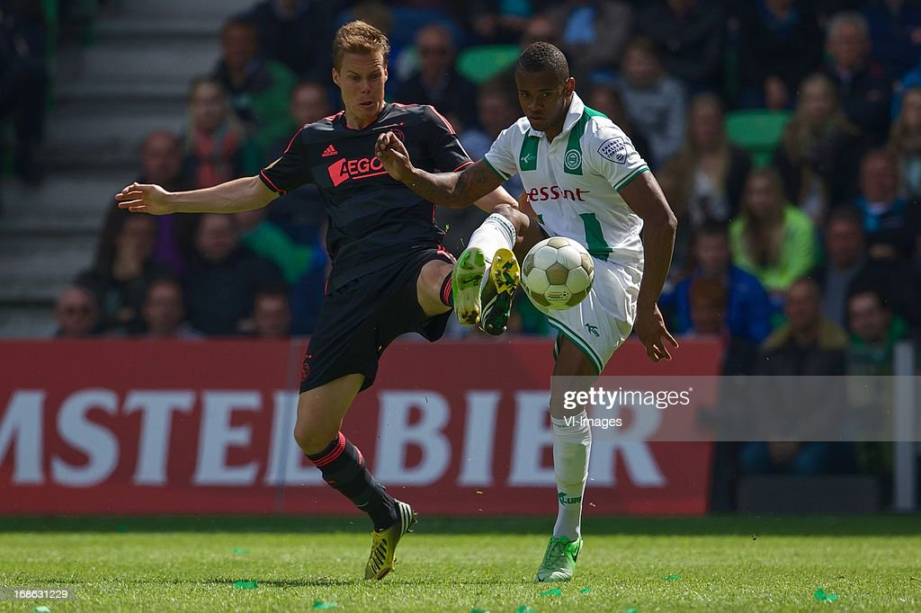 Niklas Moisander of Ajax, Leandro Bacuna of FC Groningen during the Dutch Eredivisie match between FC Groningen and Ajax on May 12, 2013 at the Euroborg stadium in Groningen, The Netherlands.