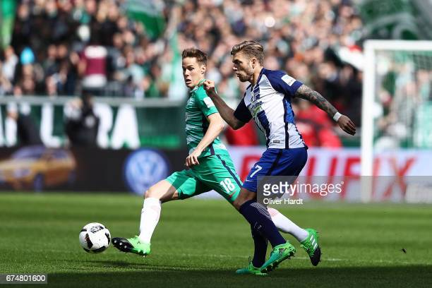 Niklas Moisander of Bremen and Alexander Esswein of Berlin compete for the ball during the Bundesliga match between Werder Bremen and Hertha BSC at...