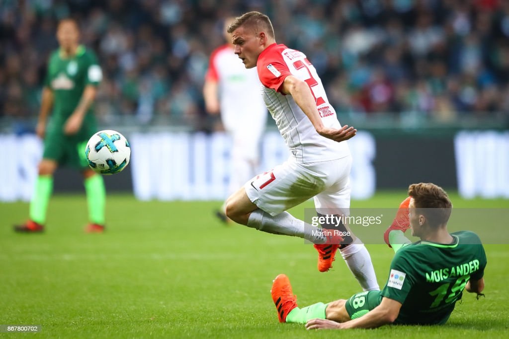 Niklas Moisander of Bremen (R) and Alfred Finnbogason of Augsburg battle for the ball during the Bundesliga match between SV Werder Bremen and FC Augsburg at Weserstadion on October 29, 2017 in Bremen, Germany.