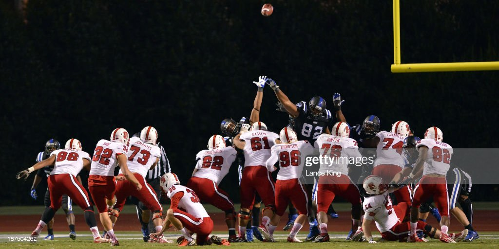 Niklas Sade #32 of the North Carolina State Wolfpack kicks for an extra point against the Duke Blue Devils at Wallace Wade Stadium on November 9, 2013 in Durham, North Carolina. Duke defeated NC State 38-20.