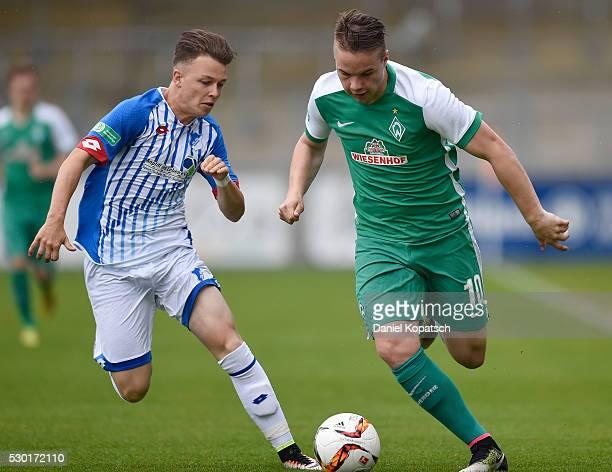 Niklas Schmidt of Bremen is challenged by Dennis Geiger of Hoffenheim during the German U19 Championship Semi Final First Leg match between 1899...