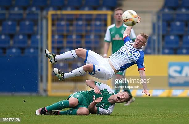 Niklas Schmidt of Bremen is challenged by Philipp Ochs of Hoffenheim during the German U19 Championship Semi Final First Leg match between 1899...