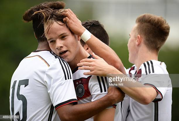 Niklas Schmidt of Germany celebrates with teammates after scoring his team's second goal during the KOMM MIT tournament match between U17 Germany and...