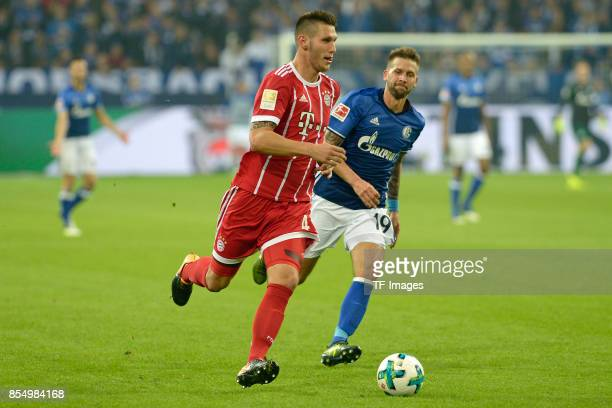 Niklas Süle of Muenchen and Guido Burgstaller of Schalke battle for the ball during the Bundesliga match between FC Schalke 04 and FC Bayern Muenchen...