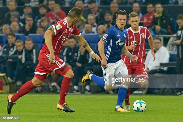 Niklas Süle of Muenchen and Yevhen Konoplyanka of Schalke Joshua Kimmich of Muenchen battle for the ball during the Bundesliga match between FC...
