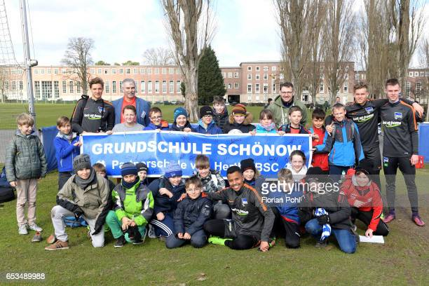 Niklas Stark Allan Maximilian Mittelstaedt and Julius Kade of Hertha BSC together with students of the elementary school from Bernau during the...