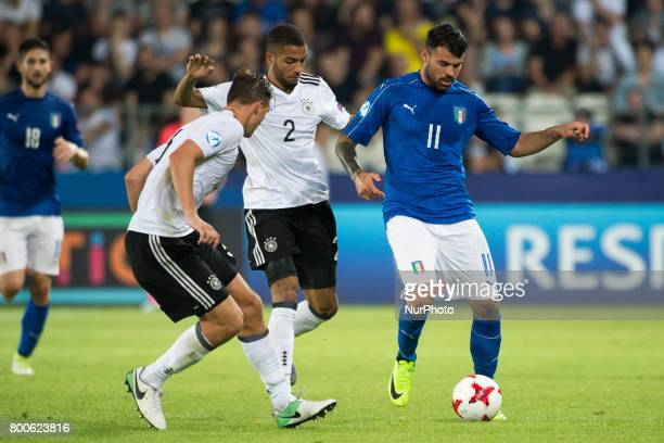 Niklas Stark and Jeremy Toljan of Germany fight for the ball with Andrea Petagna of Italy during the UEFA European Under21 Championship 2017 Group C...