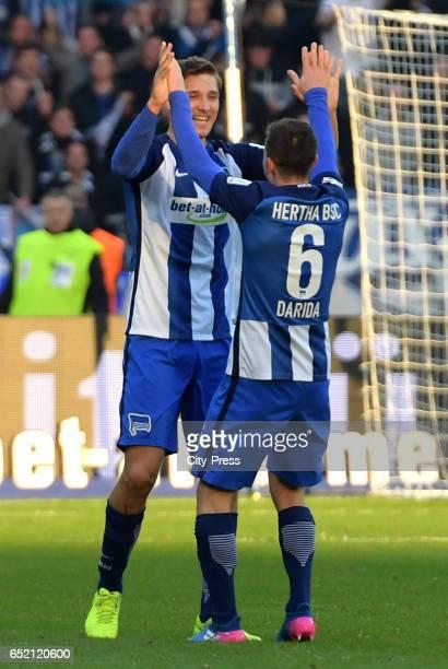 Niklas Stark and Vladimir Darida of Hertha BSC celebrate the 21 win after the Bundesliga match between Hertha BSC and Borussia Dortmund at the...