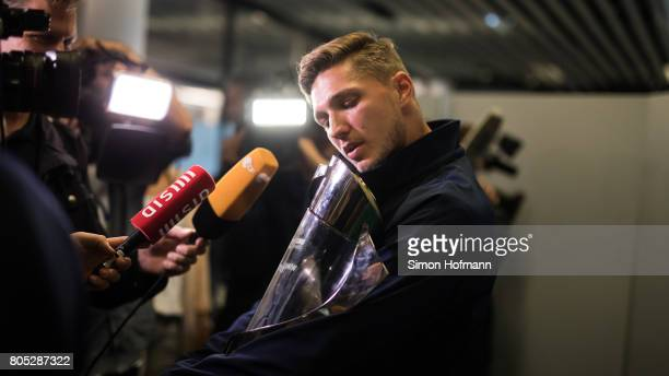 Niklas Stark carries the trophy during the Germany U21 National Team arrival at Frankfurt International Airport on July 1 2017 in Frankfurt am Main...