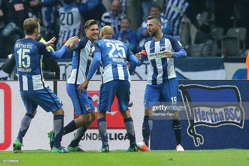 Niklas Stark (C) of Berlin jubilates with team mates after scoring the third goal during the Bundesliga match between Hertha BSC and 1. FC Koeln at Olympiastadion on October 22, 2016 in Berlin, Germany.