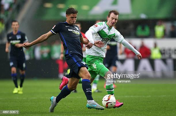 Niklas Stark of Berlin vies with Maximilian Arnold of Wolfsburg during the Bundesliga match between VfL Wolfsburg and Hertha BSC at Volkswagen Arena...