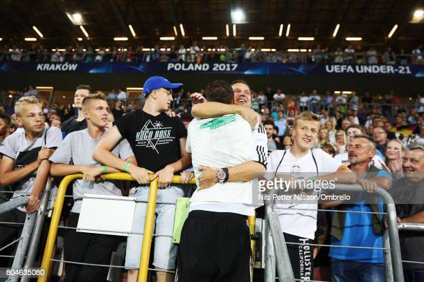 Niklas Stark of Germany celebrates with family after the during the UEFA U21 Final match between Germany and Spain at Krakow Stadium on June 30 2017...