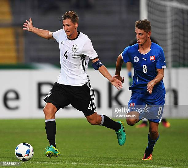 Niklas Stark of Germany is challenged by Martin Chrien of Slovakia during the Under21 friendly match between U21 Germany and U21 Slovakia at...