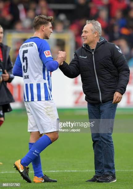 Niklas Stark of Hertha BSC and coach Christian Streich of SC Freiburg after the game between SC Freiburg and Hertha BSC on October 22 2017 in...