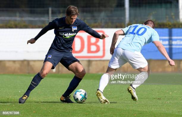 Niklas Stark of Hertha BSC and Gino Krumnow of the police epresentative team during the test match between Hertha BSC and the police epresentative...