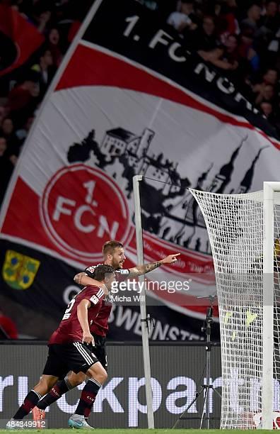 Niklas Stark of Nuernberg celebrates with Guido Burgstaller of Nuernberg after scoring his team's second goal during the second Bundesliga match...