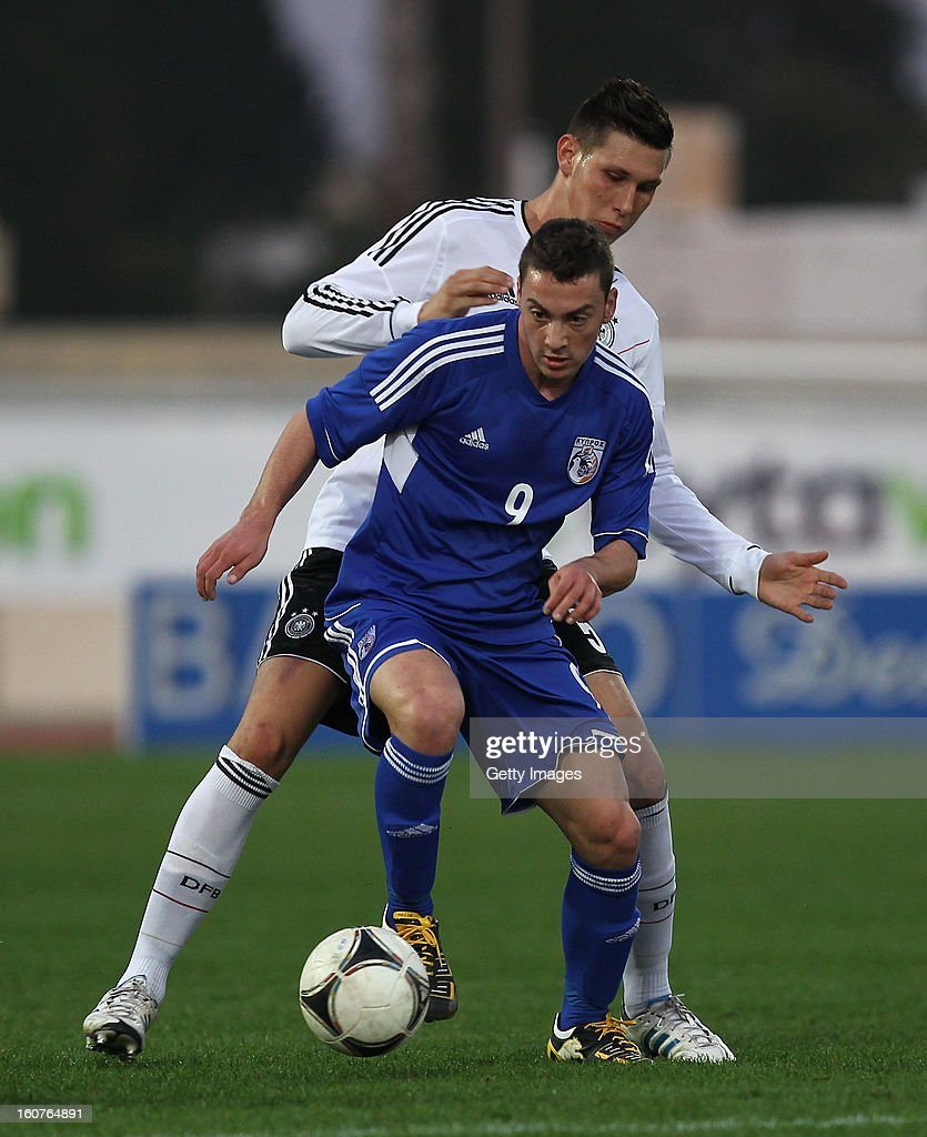 Niklas Suehle of Germany challenges Makris Andreas of Cyprus during the international friendly match between U18 Cyprus and U18 Germany at Stadio Tasos Markou on February 5, 2013 in Paralimni, Cyprus.