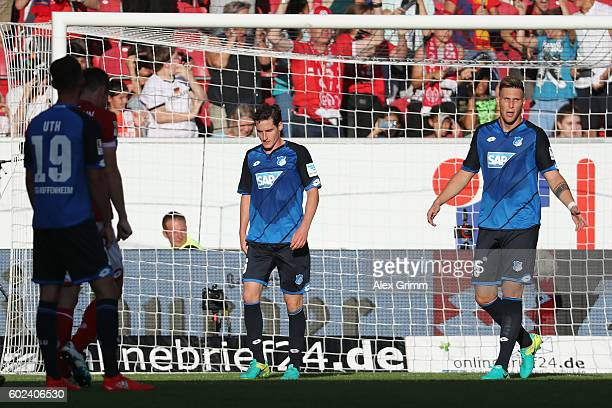 Niklas Suele and Sebastian Rudy of Hoffenheim react during the Bundesliga match between 1 FSV Mainz 05 and TSG 1899 Hoffenheim at Opel Arena on...