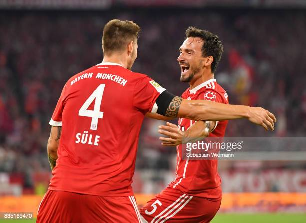 Niklas Suele of Bayern Munich celebrates scoring the first goal of the match and season with Mats Hummels of Bayern Munich during the Bundesliga...