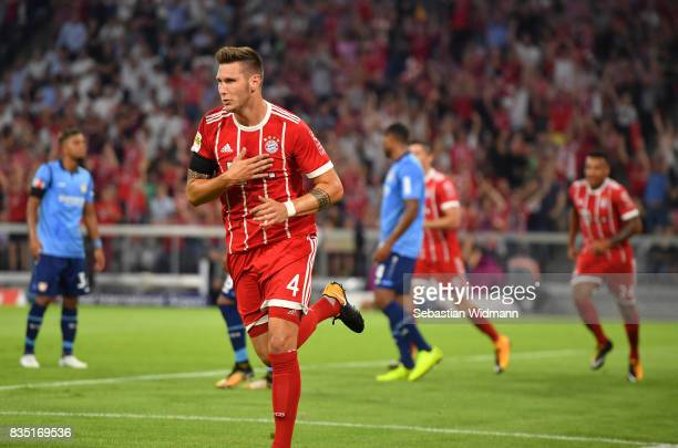 Niklas Suele of Bayern Munich celebrates scoring the first goal of the match and season during the Bundesliga match between FC Bayern Muenchen and...