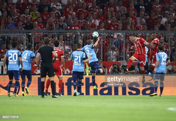 Niklas Suele of Bayern Munich heads to score the first goal of the match and the season during the Bundesliga match between FC Bayern Muenchen and...