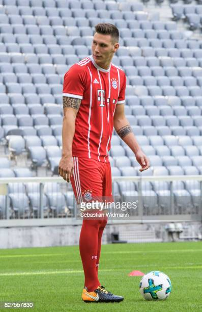 Niklas Suele of FC Bayern Muenchen arrives for the group picture during the team presentation at Allianz Arena on August 8 2017 in Munich Germany