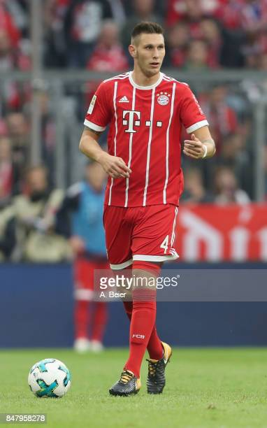 Niklas Suele of FC Bayern Muenchen kicks the ball during the Bundesliga match between FC Bayern Muenchen and 1 FSV Mainz 05 at Allianz Arena on...