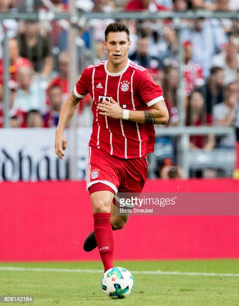 Niklas Suele of FC Bayern Muenchen runs with the ball during the Audi Cup 2017 match between SSC Napoli and FC Bayern Muenchen at Allianz Arena on...