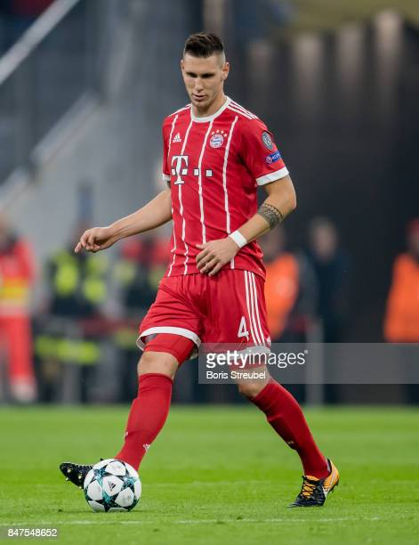 Niklas Suele of FC Bayern Muenchen runs with the ball during the UEFA Champions League group B match between Bayern Muenchen and RSC Anderlecht at...