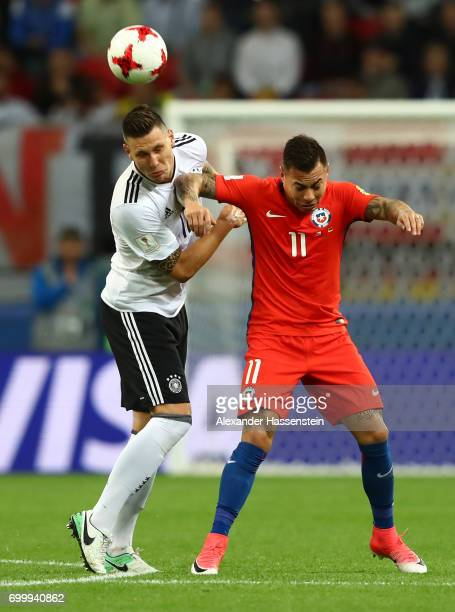 Niklas Suele of Germany and Eduardo Vargas of Chile battle for possession during the FIFA Confederations Cup Russia 2017 Group B match between...