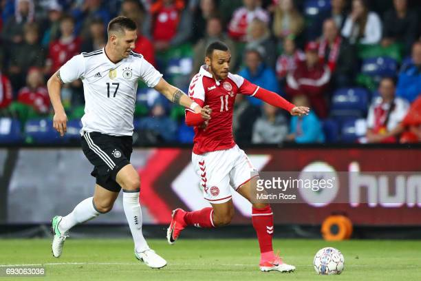 Niklas Suele of Germany and Martin Braithwaite of Denmark battle for the ball during the international friendly match between Denmark v Germany on...