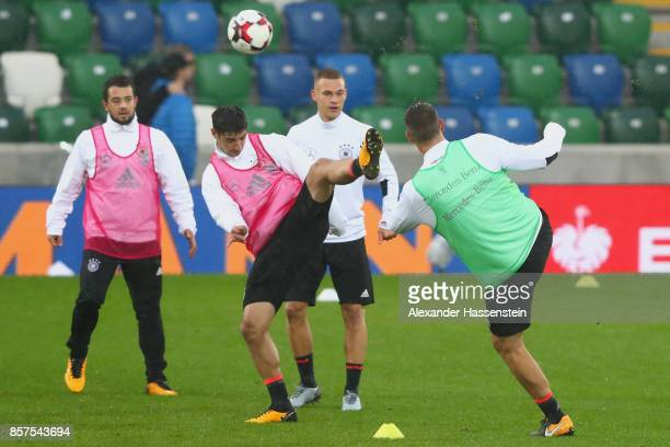 Niklas Suele of Germany battles for tha ball with his team mate Lars Stindl during a team Germany training session at Windosor Park ahead of their...