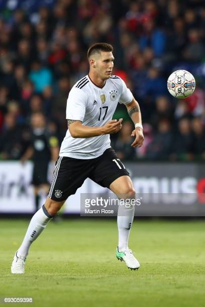 Niklas Suele of Germany controls the ball during the international friendly match between Denmark v Germany on June 6 2017 in Brondby Denmark
