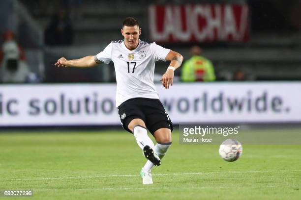 Niklas Suele of Germany kicks the ball during the international friendly match between Denmark v Germany on June 6 2017 in Brondby Denmark