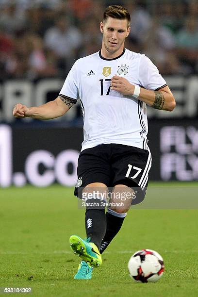 Niklas Suele of Germany plays the ball during the international friendly match between Germany and Finland at BorussiaPark on August 31 2016 in...