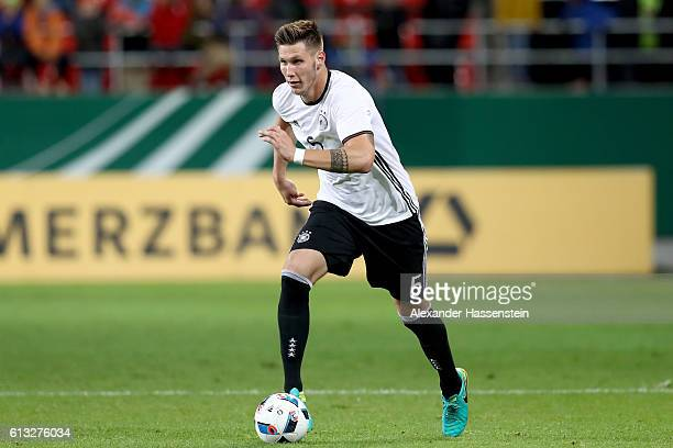 Niklas Suele of Germany runs with the ball during the 2017 UEFA European U21 Championships Qualifier between Germany and Russia at Audi Sportpark on...
