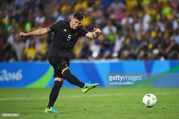 Niklas Suele of Germany scores his penalty in the shoot out during the Men's Football Final between Brazil and Germany at the Maracana Stadium on Day...