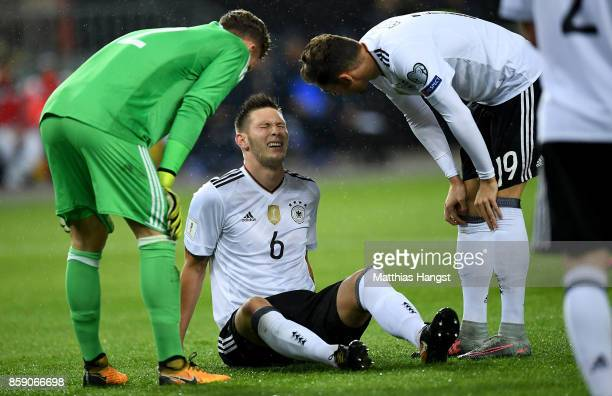 Niklas Suele of Germany sits injury on the pitch during the FIFA 2018 World Cup Qualifier between Germany and Azerbaijan at FritzWalterStadion on...