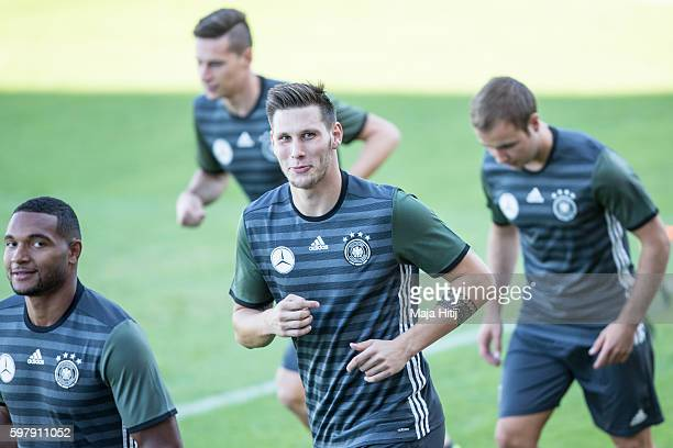 Niklas Suele of Germany with his team mates during a Germany training session prior a friendly soccer match against Finland on August 30 2016 in...