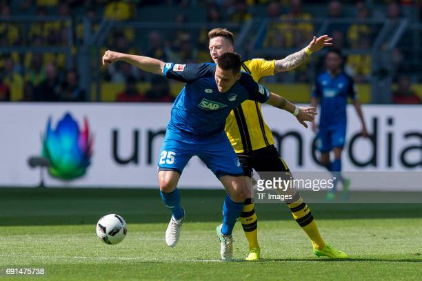 Niklas Suele of Hoffenheim and Marco Reus of Dortmund battle for the ball during the Bundesliga match between Borussia Dortmund and TSG 1899...