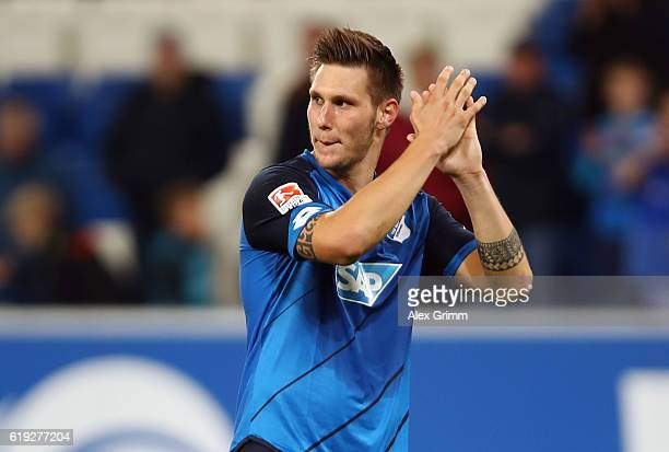Niklas Suele of Hoffenheim celebrate with the fans after the Bundesliga match between TSG 1899 Hoffenheim and Hertha BSC at Wirsol RheinNeckarArena...