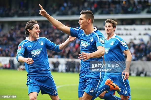 Niklas Suele of Hoffenheim celebrates his team's second goal with his team mate Sebastian Rudy of Hoffenheim during the Bundesliga match between 1899...