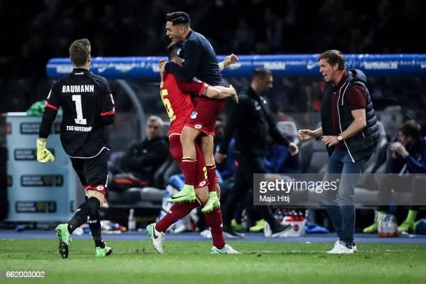 Niklas Suele of Hoffenheim celebrates with Nadiem Amiri after scoring a goal to make it 12 during the Bundesliga match between Hertha BSC and TSG...